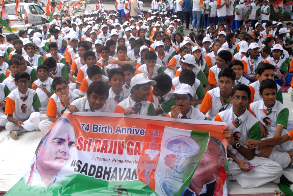 Students gather to participate in the Sadbhavna Run organised on former Prime Minister Late Rajiv Gandhi's birth anniversary in Hyderabad on Aug 20, 2017. - Late Rajiv Gandh and Rajiv Gandhi