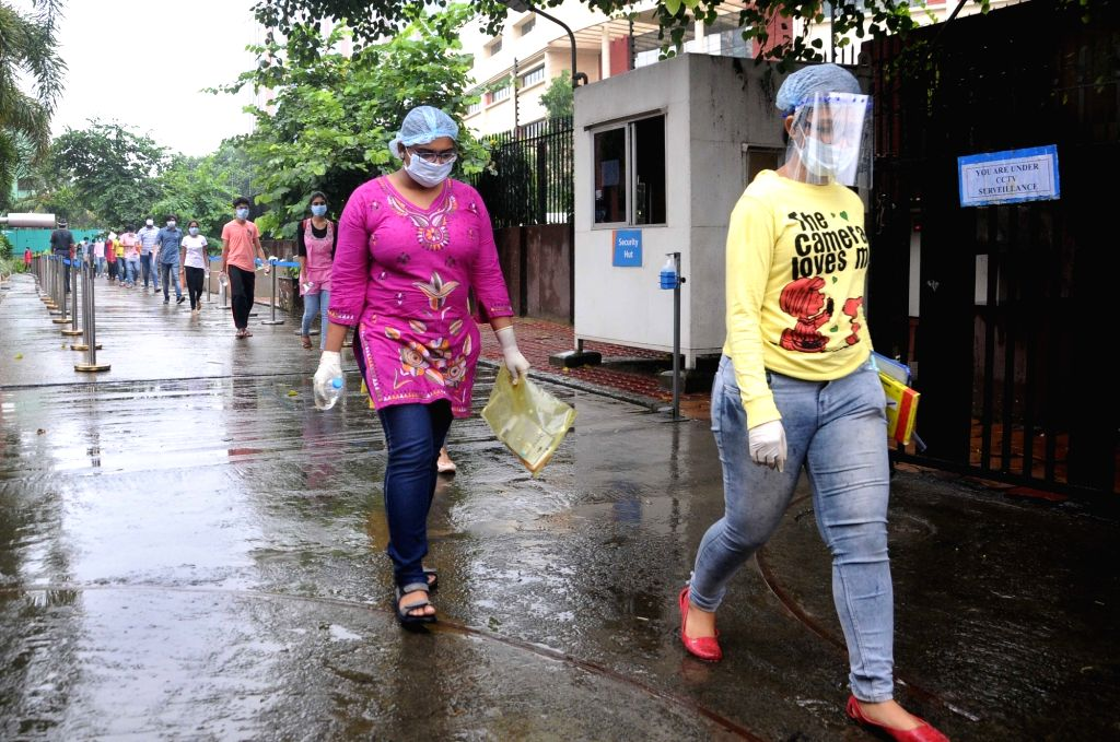 Students leave the examination center after appearing for the Joint Entrance Examination (JEE) Mains 2020 amid the COVID-19 pandemic, in Kolkata on Sep 1, 2020.