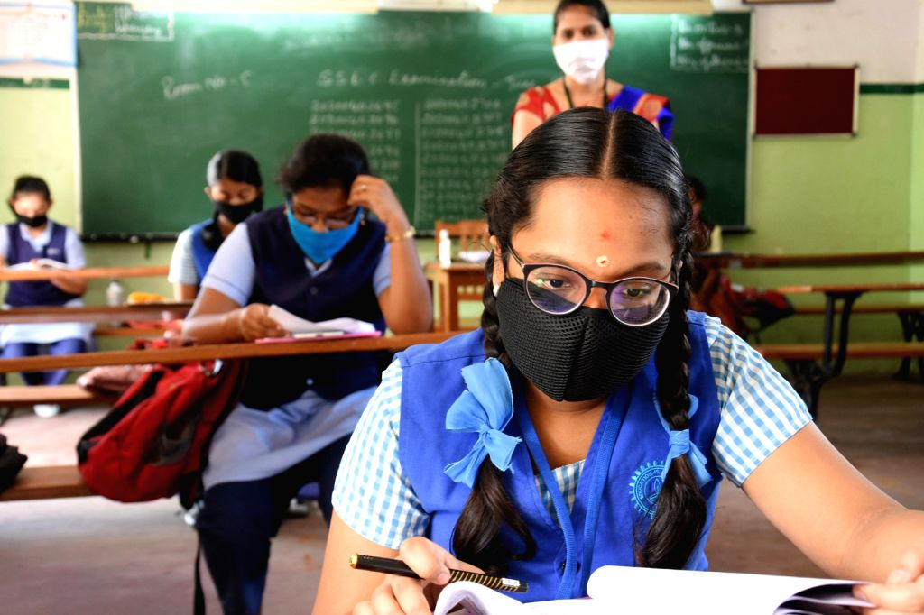 Students maintain social distance as they appear for their remaining Secondary School Leaving Certificate (SSLC) examinations, in Bengaluru on June 25, 2020.