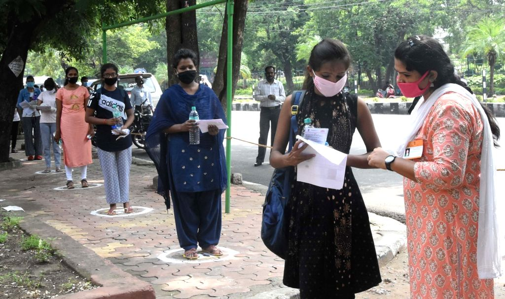 Students maintaining social distance appeared for NEET exam in Bhopal on September 13, 2020.