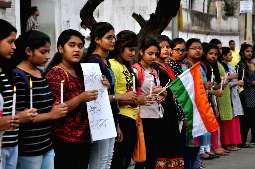 Students make a human chain to protest against suicide attack on a CRPF bus in Jammu and Kashmir's Pulwama district in which atleast 45 soldiers lost their lives; in Kolkata on Feb 15, 2019.