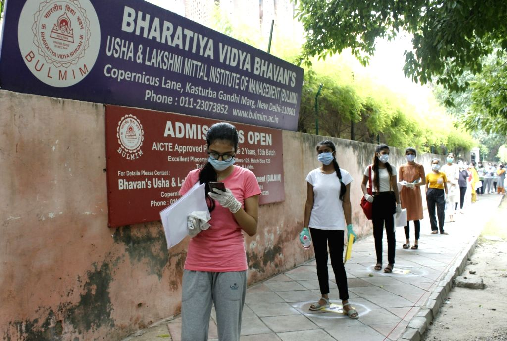 Students moving in the queue at the main gate of  NEET (UG)  Exam center, Bharatiya Vidya Bhawan in New Delhi on September 13, 2020.