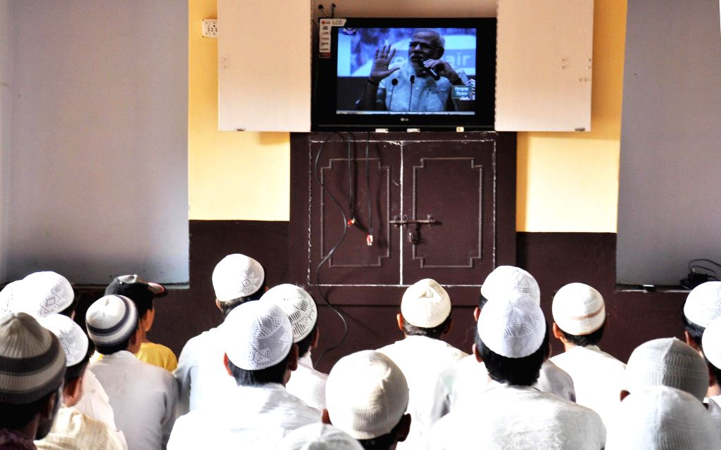 Students of a Lucknow Madarsa watch as Prime Minister Narendra Modi addresses school students across the nation on Sept 5, 2014. (Photo: IANS) - Narendra Modi