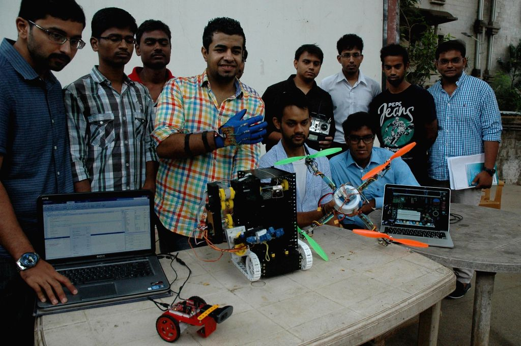 Students of an engineering college display their robots during a press conference in Bangalore on May 7, 2014.