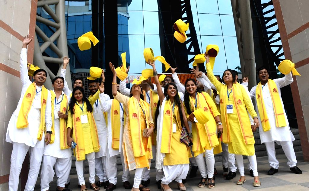 Students of Aryabhatta Knowledge University (AKU) celebrate after receiving their degrees during the 6th annual convocation, at Bapu Sabhagar in Patna, on Sep 14, 2019.
