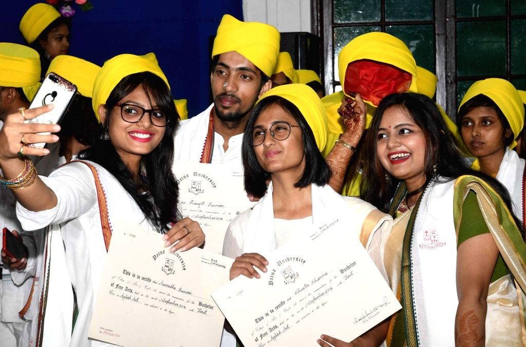 Students of College of Arts & Crafts, Patna University pose for selfies during their convocation ceremony, on Sep 6, 2019.