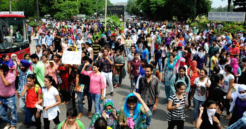 Students of Guru Nanak Dev University demonstrate against university management in Amritsar on Aug 11, 2014.