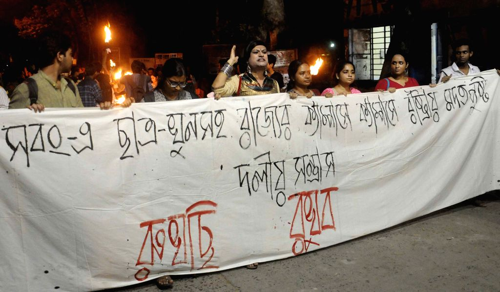 Students of Jadavpur University take out a torch light protest vigil in memory of Krishprasad Jana of Sabong college in Kolkata, on Aug 10, 2015. Jana was allegedly beaten to death in a ... - Soumen Kumar Mahapatra