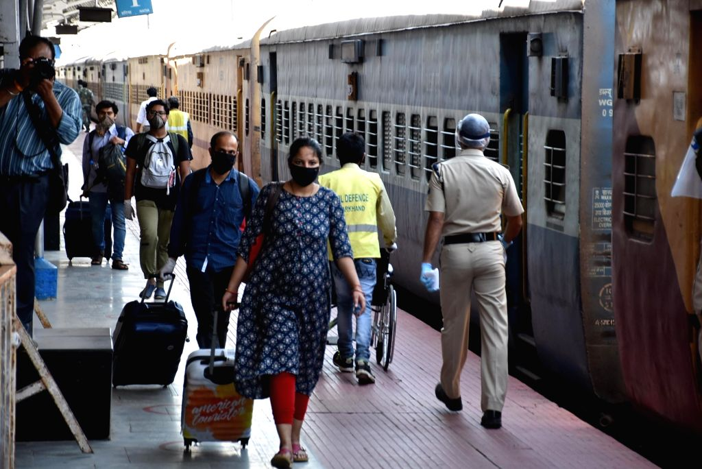 Students of Jharkhand who arrive from Bengaluru through special train at Hatia Railway Station during the extended nationwide lockdown imposed to mitigate the spread of coronavirus, in Ranchi ...