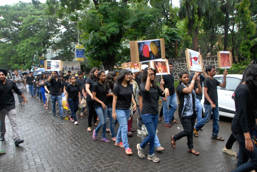 Students of Khalsa College during a silent protest for crime against women in Mumbai on Aug. 9, 2014.