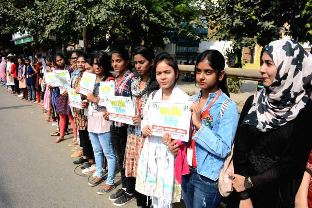 Students of Magadh Mahila College forma a human chain during 'Walk for Life' awareness campaign to mark World Diabetes Day, in Patna on Nov 15, 2019.