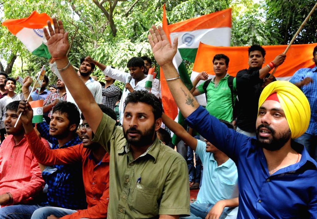 Students of NIT Srinagar stage a demonstration at Jantar Mantar in New Delhi on April 20, 2016.