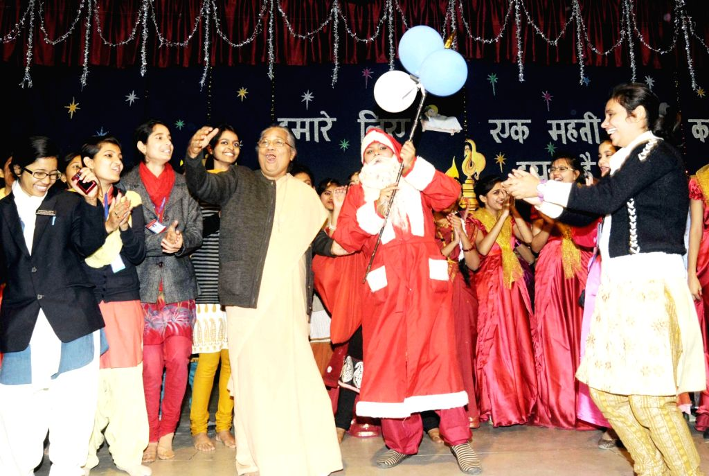 Students of Patna Women's College celebrate Christmas in Patna on Dec.20, 2013.