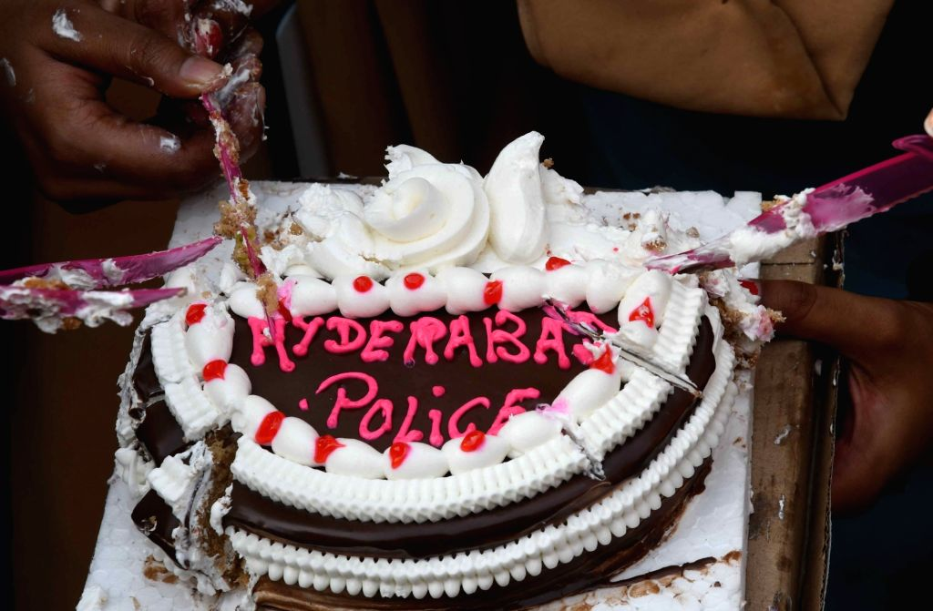 Students of Patna Women's College cut a cake in the name of Hyderabad Police after it shot dead all the four accused of brutally gang raping and murdering a young veterinarian in Hyderabad, ... - Ranga Reddy
