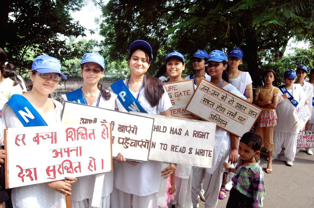 Students of Patna Women's College form a human chain demanding education for all, a day after International Literacy Day in Patna on Sept 9, 2014.