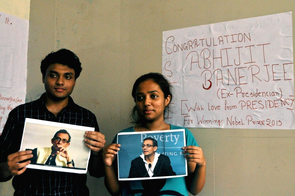 Students of Presidency University hold the posters of Abhijit Vinayak Banerjee, who won the Nobel prize for Economics, as a gesture to congratulate him, in Kolkata on Oct 16, 2019. - Abhijit Vinayak Banerjee