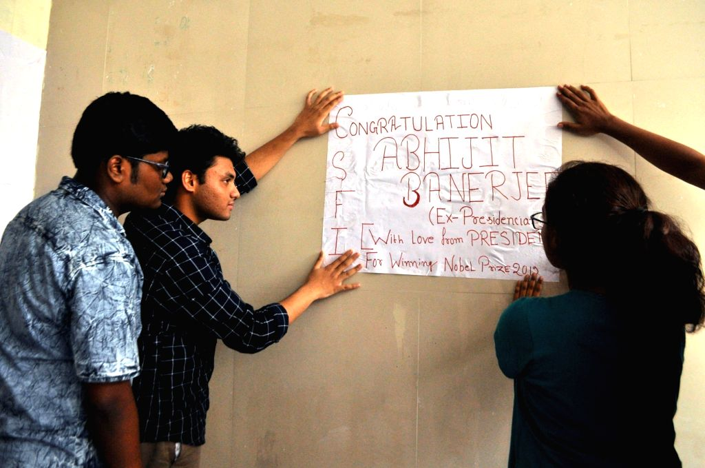 Students of Presidency University paste a congratulatory note for Abhijit Vinayak Banerjee who won the Nobel prize for Economics, in Kolkata on Oct 16, 2019. - Abhijit Vinayak Banerjee