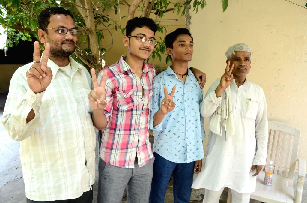 Students of 'Super 30' celebrate in Patna on June 11, 2017. All 30 students coached by Bihar's 'Super 30', a free coaching centre for underprivileged students, have cracked the highly ...