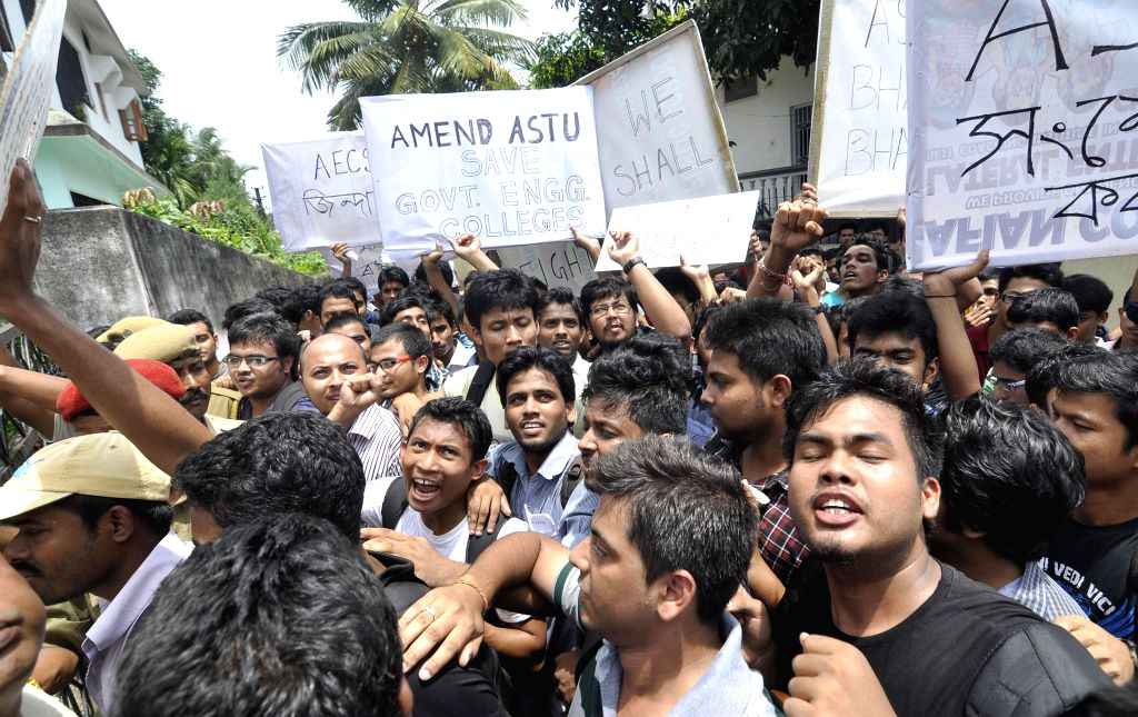 Students of the Assam Engineering College (AEC), Jalukbari stage a demonstration in front of Assam Science and Technology University, Hatigaon  on July 30, 2014.