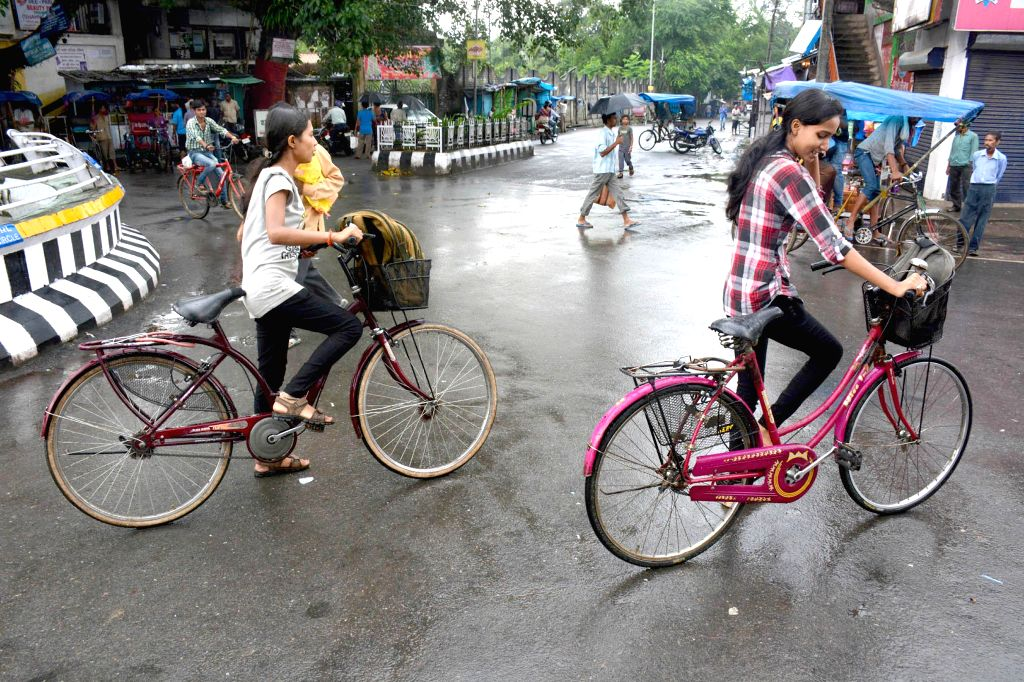 Students on their way to tutions on the 2nd day of curfew relaxations until 12pm as normalcy gradually returns in the tension-gripped Golaghat in Assam on Aug 23, 2014.