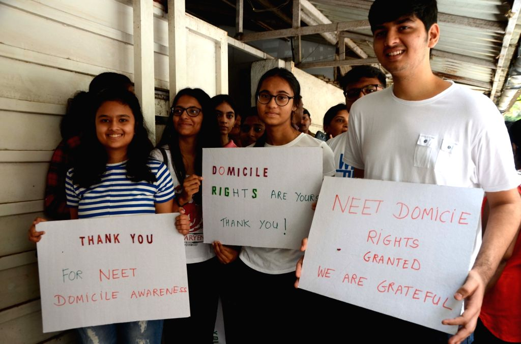 "Students outside Maharashtra Navnirman Sena (MNS) chief Raj Thackeray's residence carry placards saying ""Thank You"" after the Bombay High Court pronouncing its verdict over National ..."