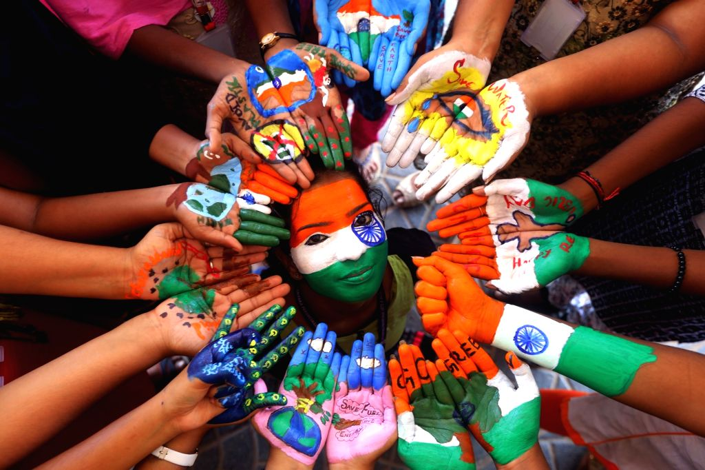 Students paint their faces and palms during Republic Day celebrations in Chennai, on Jan 25, 2019.