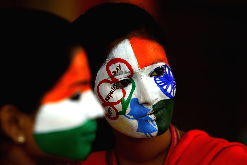 Students paint their faces during Republic Day celebrations in Chennai, on Jan 25, 2019.