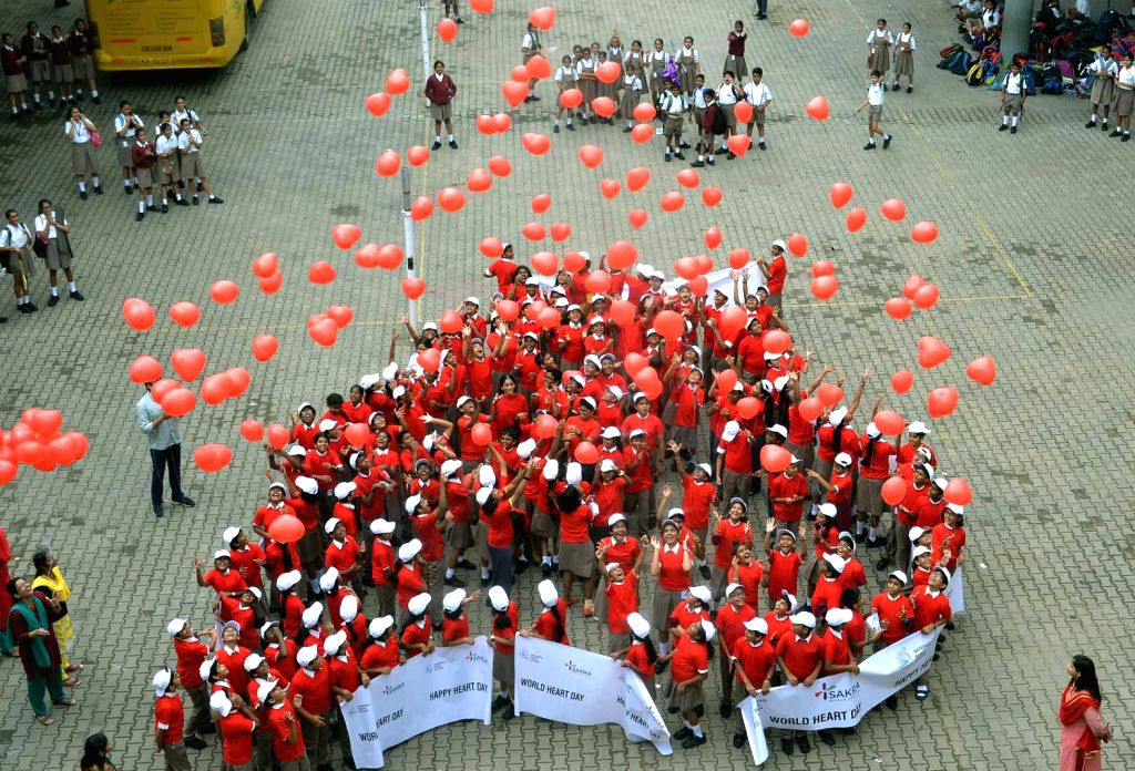 Students participate during World Heart Day rally organised by Tathagat Heart Care Centre at Freedom Park in Bengaluru on Sept 29, 2016.