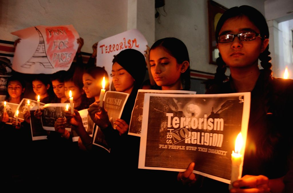 Students participate in a candlelight vigil to show solidarity with the victims of 13/11 Paris blasts in Amritsar, on Nov 16, 2015.