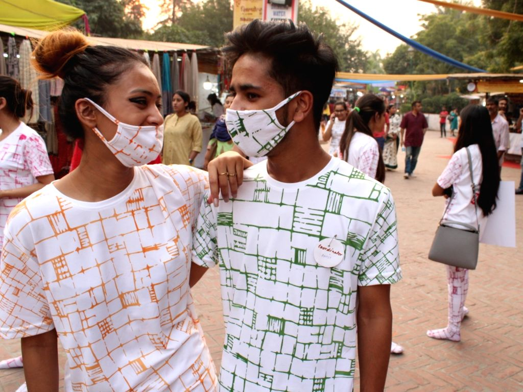 """Students participate in a """"Fashion March"""" to spread awareness regarding air pollution and usage of masks at Dilli Haat, INA in New Delhi, on Nov 2, 2018."""