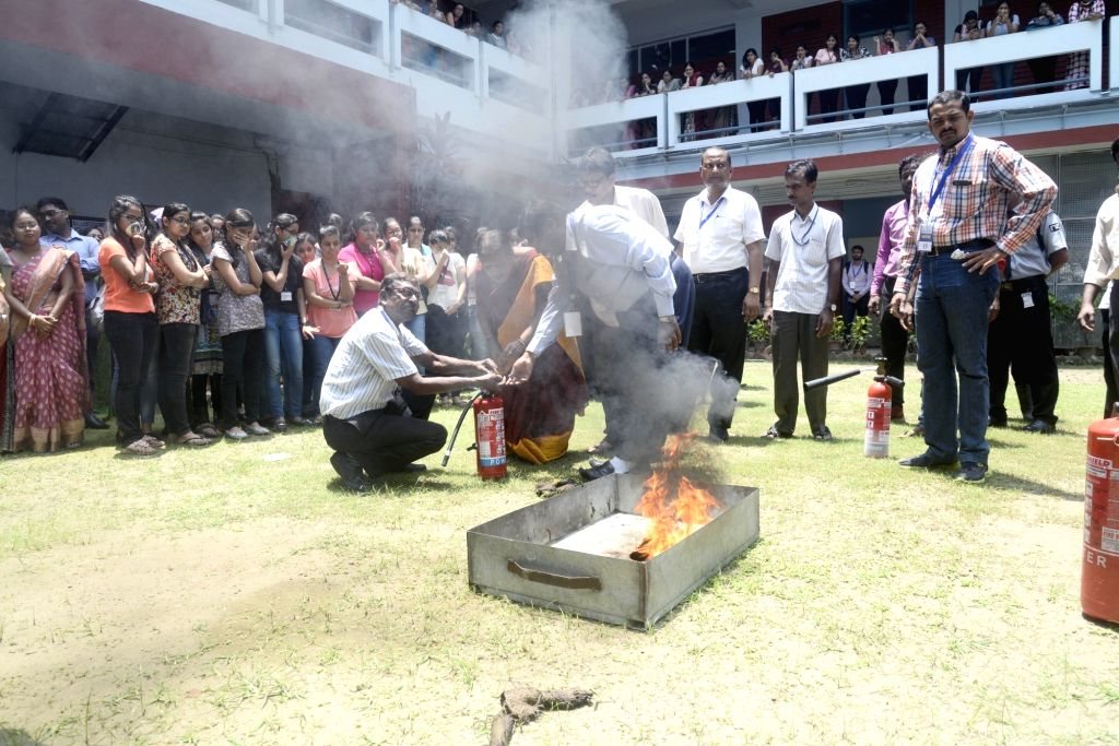Students participate in a fire and security mock drill at a college in Kolkata on August 09, 2017.