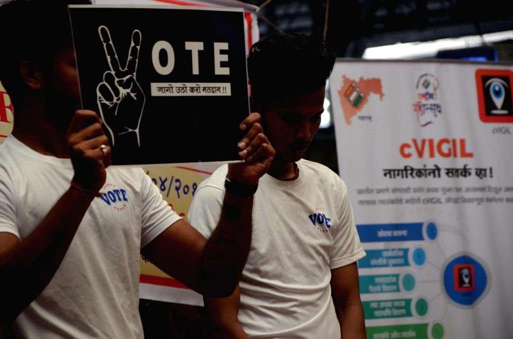Students participate in a flash mob urging people to cast their votes for the forthcoming Lok Sabha elections, during a voters awareness programme organised by the District Election Officer, ...