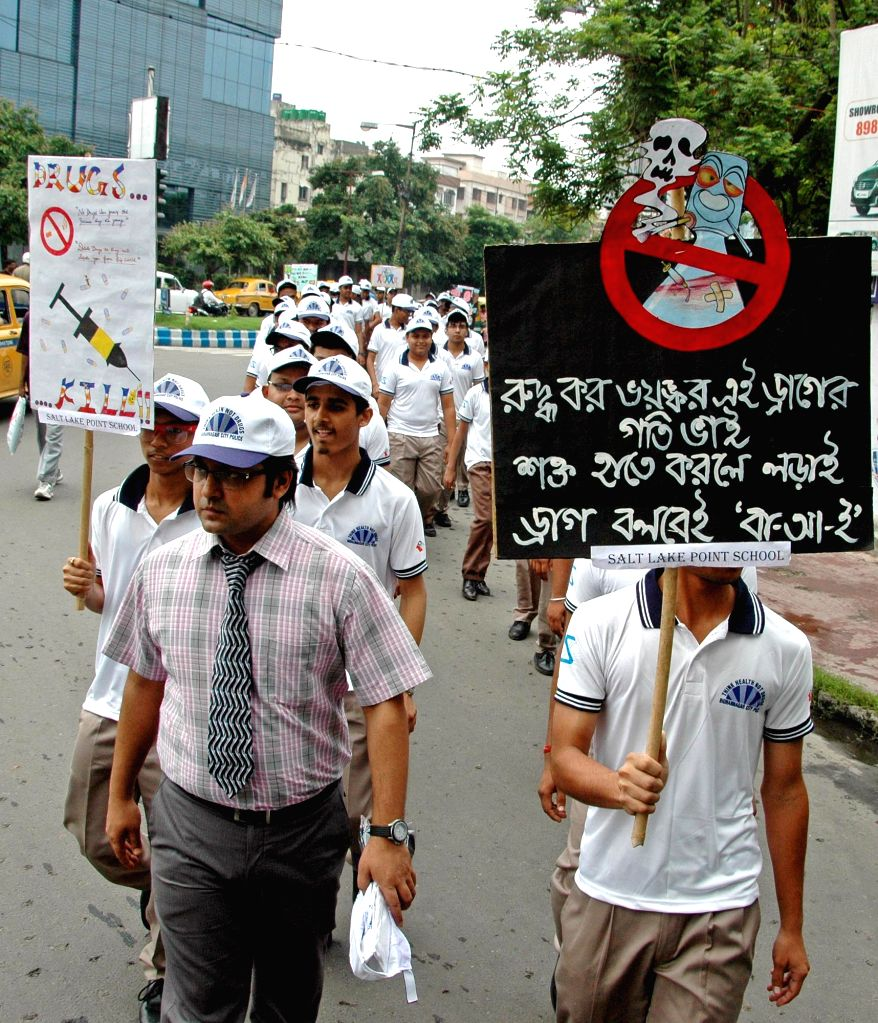 Students participate in a rally organised by Bidhannagar City Police on the occassion of the International Day Against Drug Abuse and Illicit Trafficking in Kolkata on June 26, 2015.