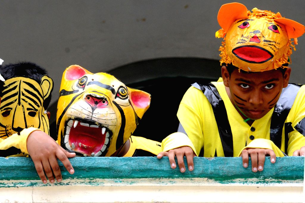 Students participate in a sit and draw competition organised on Global Tiger Day at St. Joseph College in Kolkata on July 23, 2014.