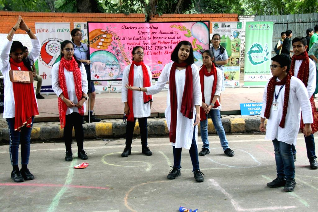 Students participate in a street play to raise awareness among people against the use of plastic to save the environment, at Jantar Mantar in New Delhi on Sep 27, 2019.