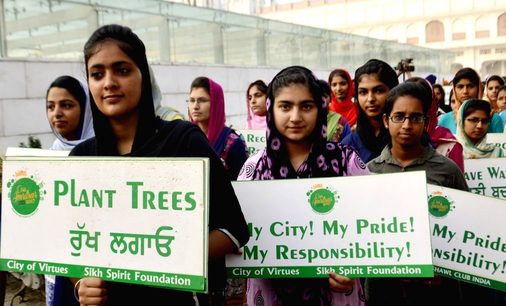 Students participate in an environmental awareness march organised to mark the 440th Amritsar Foundation Day, in Amritsar on June 27, 2017.