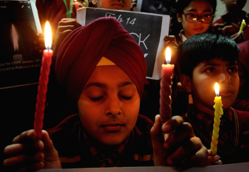 Students participate mourn the killing of 45 Central Reserve Police Force (CRPF) troopers in Jammu and Kashmir's Pulwama district yesterday; in Amritsar on Feb 15, 2019.