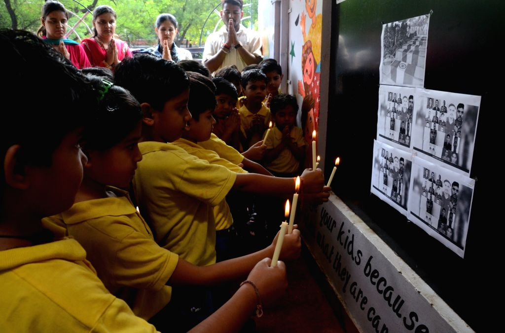 Students pay tribute to 18 Sept Uri martyrs in Bhopal on Sept 20, 2016.