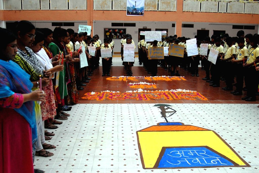 Students pay tribute to soldiers killed in Uri terror attack, in Ahmedabad on Sept 19, 2016.