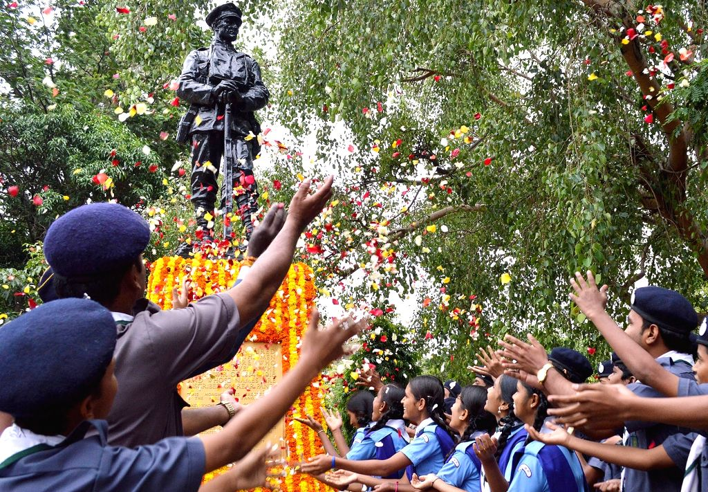 Students pay tributes to martyrs on the 20th Anniversary of Kargil Vijay Diwas, at the National Military Memorial in Bengaluru on July 26, 2019.