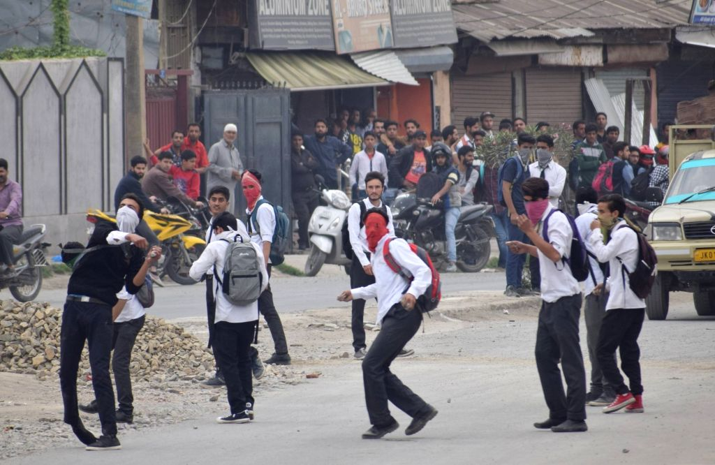 Students pelt stones on security personnel in Srinagar on May 11, 2017.