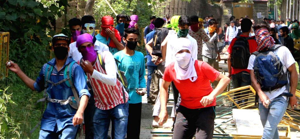 Students pelt stones on security personnel in Srinagar on May 15, 2017.
