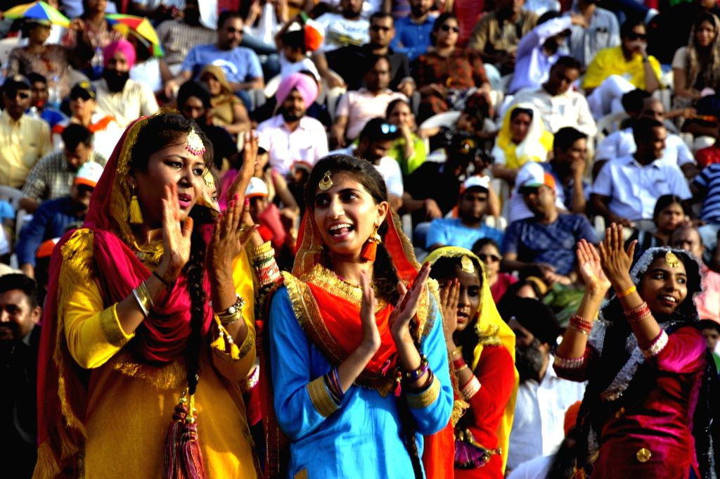 Students perform during a ceremony to mark Independence Day celebrations at the India-Pakistan Wagah border post near Amritsar on Aug. 15, 2017.