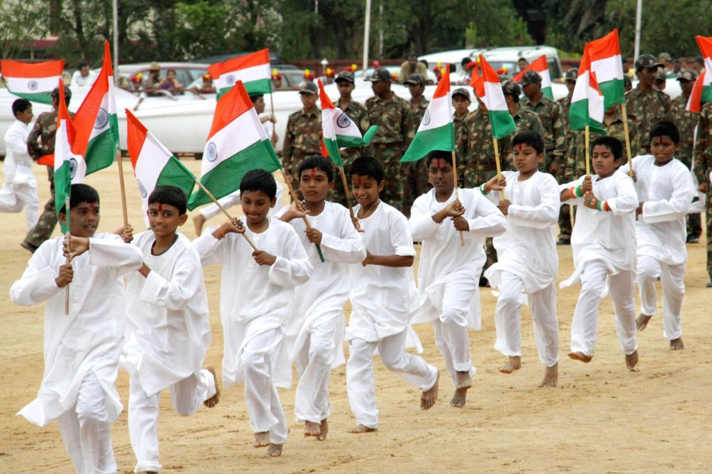 Students performing during Independence Day parade at Manekshaw Parade Grounds , in Bangalore on Thursday 15th August 2013. (Photo::: IANS)