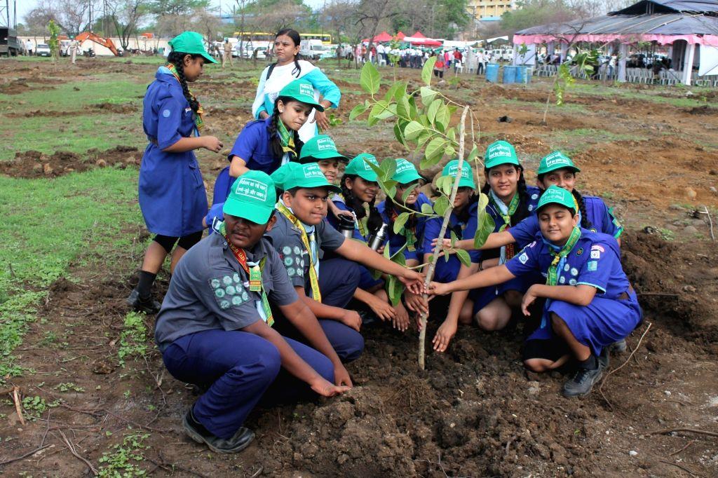 Students plant saplings to mark 'Vanamahotsav' - forest festival- in Nagpur on July 1, 2016.
