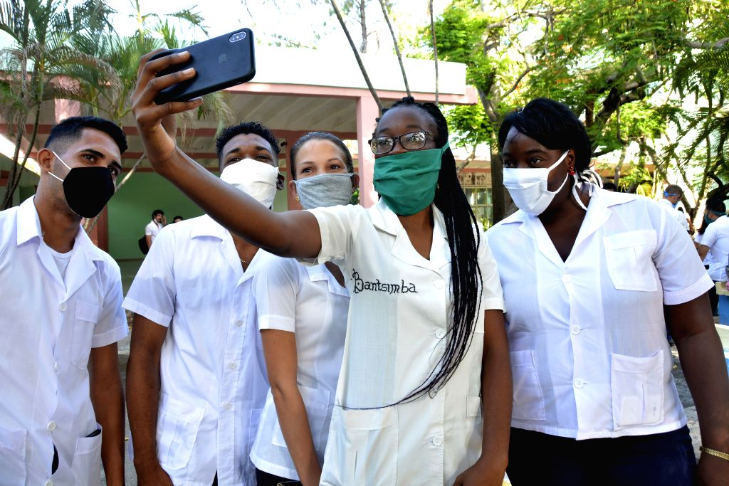 Students pose for photos at a medical college in Cienfuegos Province of Cuba, Sept. 1, 2020. Schools in most parts of Cuba reopened on Tuesday.