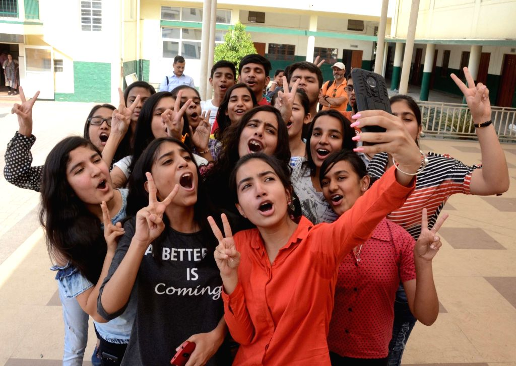 Students pose for selfies as they celebrate after the Central Board of Secondary Education (CBSE) declared the results of Class 10 examinations, in Bhopal on May 29, 2018. Students from ...