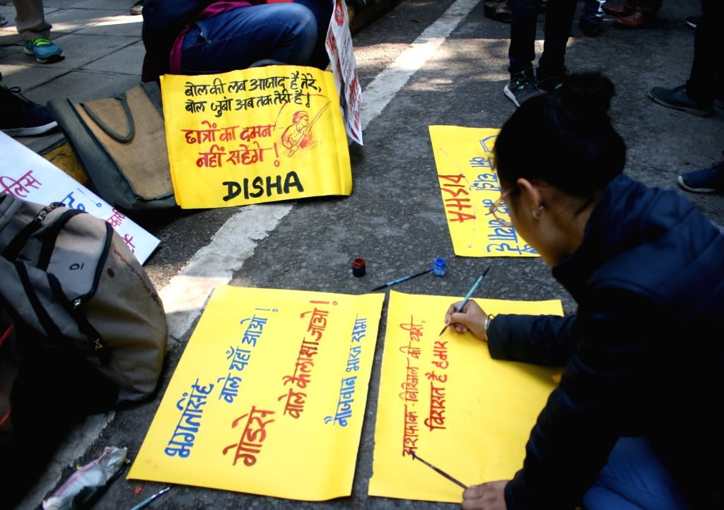 Students prepare placards to participate in a protest rally taken out from Mandi House towards the HRD Ministry, against recent violence at JNU demanding the resignation of the Vice ...