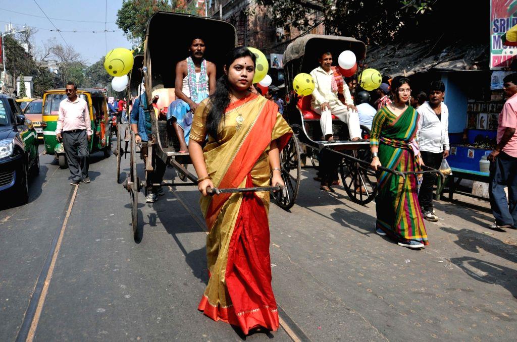 Students pull a rickshaw puller on Valentine's Day in Kolkata, on Feb 14, 2019.