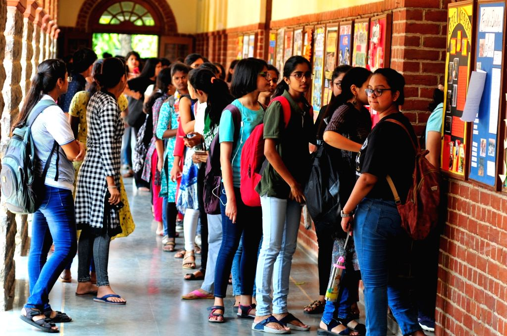 Students queue up to cast their votes during Delhi University Students' Union (DUSU) election, in New Delhi on Sept 12, 2018.
